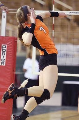 Winter Park's Christina Ambrose leaps to hit during the Class 8A semifinal game of Winter Park versus Jupiter in the FHSAA Girls Volleyball Finals at the Silver Spurs Arena in Kissimmee on Thursday, November 14, 2013. (Stephen M. Dowell/Orlando Sentinel)