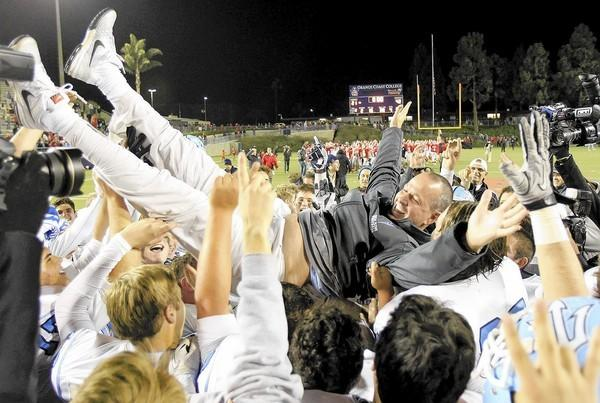 Corona del Mar High head coach Scott Meyer is held up by his players after the Sea Kings defeated Garden Grove, 42-21, in a CIF Southern Section Southern Division championship game at LeBard Stadium in Costa Mesa on Friday.