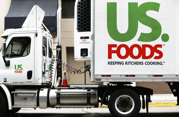 A US. Foods truck is shown on delivery in San Diego, California in this file photo from October 23, 2013. Sysco Corp said December 9, 2013 it would buy rival US Foods Inc for about $3.5 billion and assume about $4.7 billion in debt to cement its position as the biggest U.S. food distributor, driving up Sysco's shares 30 percent before the bell.