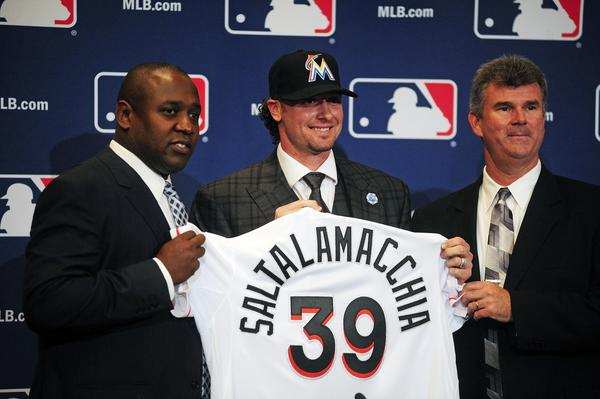 Dec 9, 2013; Orlando, FL, USA; Catcher Jarrod Saltalamacchia (center) is introduced by Miami Marlins director of baseball operations Michael Hill (left) and general manager Dan Jennings (right) during the MLB Winter Meetings at the Walt Disney World Swan and Dolphin Resort. Mandatory Credit: David Manning-USA TODAY Sports ORG XMIT: USATSI-164728