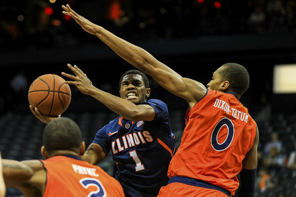 Jaylon Tate attempts a shot over Auburn's Asauhn Dixon-Tatum in the first half at Philips Arena.