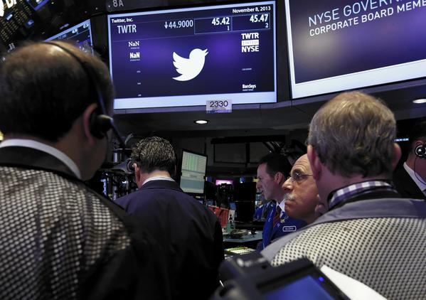 Analysts say ads targeting users for products they browsed online are only going to proliferate because they are potentially very lucrative for social networks under pressure from investors to wring more revenue from users. Above, traders last week at the post that handles Twitter on the floor of the New York Stock Exchange.