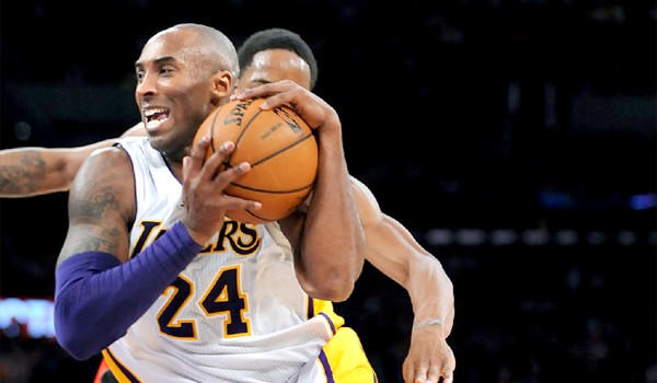 Kobe Bryant scored nine points with four assists in 28 minutes for the Lakers in his regular-season debut Sunday.