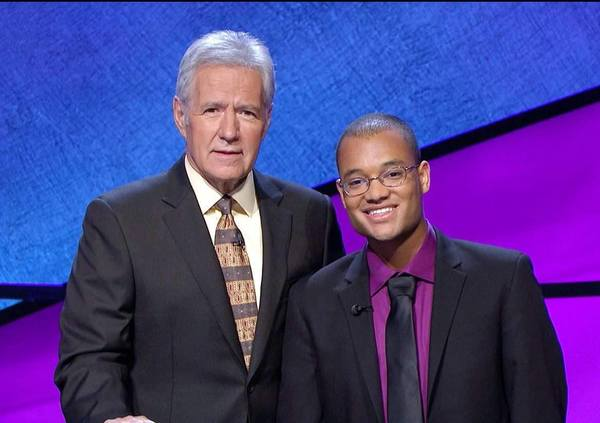 Craig Cornish Jr. (right) poses with 'Jeopardy' host Alex Trebek. The Morgan State alum has won in back-to-back nights on the popular game show.