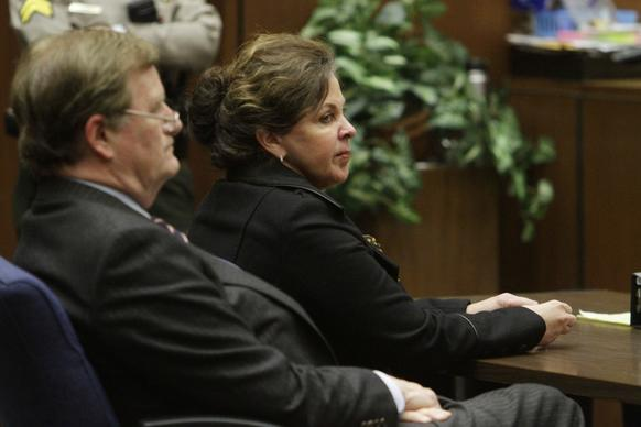 Angela Spaccia, right, Bell's former second in command, sits in a a downtown Los Angeles courtroom beside her attorney, Harland Braun, the day a jury reached verdicts in her case