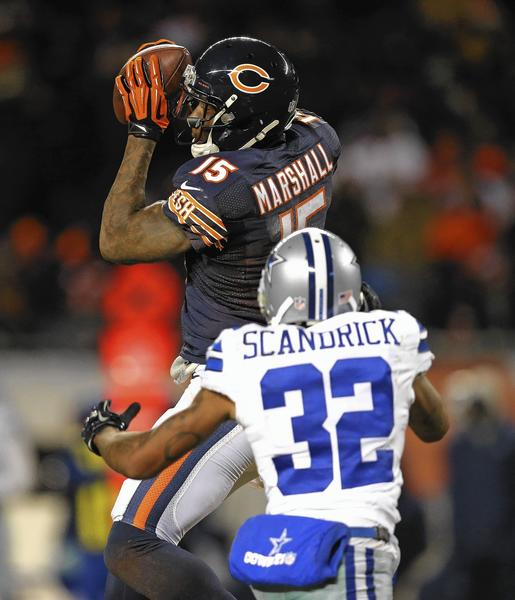 Brandon Marshall (15) of the Chicago Bears makes a first down catch over Orlando Scandrick of the Dallas Cowboys at Soldier Field on Monday night.
