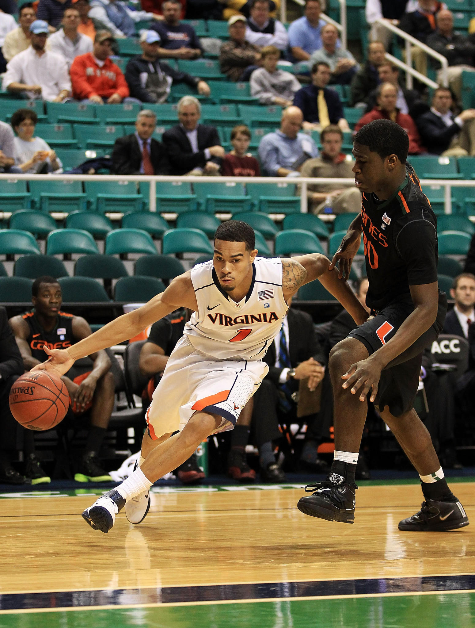 GREENSBORO, NC - MARCH 10: Mustapha Farrakhan #2 of the Virginia Cavaliers drives against Adrian Thomas #30 of the Miami Hurricanes during the first half of the first round of the 2011 ACC men's basketball tournament at the Greensboro Coliseum on March 10, 2011 in Greensboro, North Carolina. (Photo by Streeter Lecka/Getty Images) ORG XMIT: 106150150