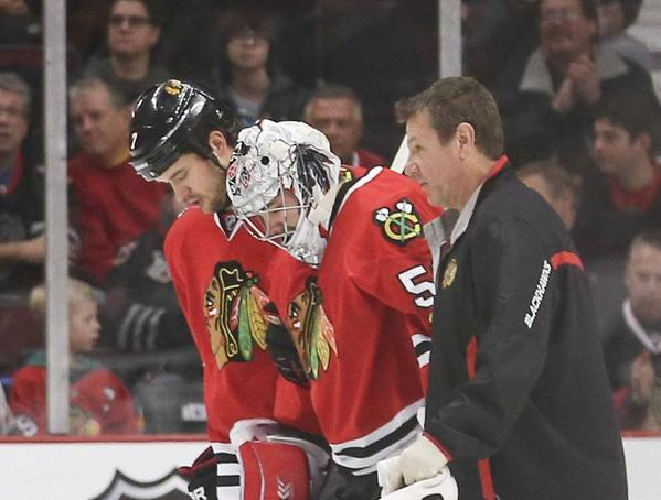 Chicago Blackhawks goalie Corey Crawford is helped off the ice after getting hurt on Dec. 8.