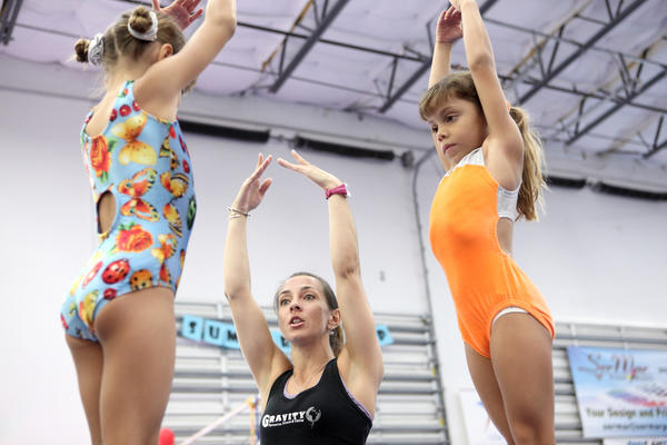 Coach Andrea Garcia training her students at Gravity Gymnastics studio, in Miramar on July 25, 2013.