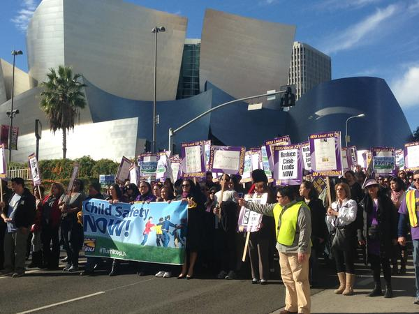 County workers represented by Service Employeees International Union Local 721 protested in downtown Los Angeles on Tuesday. Social workers are on strike seeking reduced caseloads.