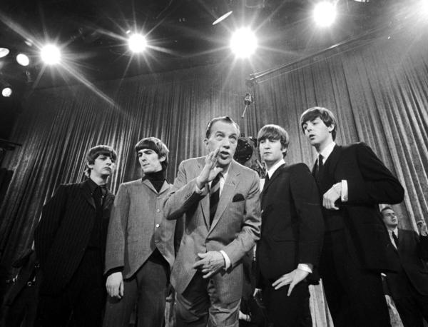 "Ed Sullivan, center, stands with the Beatles during a rehearsal for the British group's first American appearance, on ""The Ed Sullivan Show."""