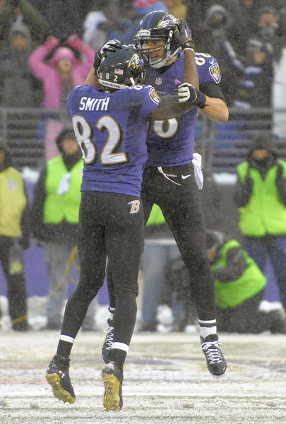 Ravens tight end Dennis Pitta celebrates a touchdown with Torrey smith during the fourth quarter against the Minnesota Vikings.