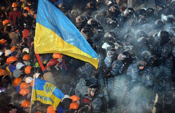 Riot police clash with protesters in Independence Square in Kiev.