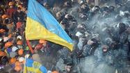 Ukraine protesters clash with police, demand president's resignation