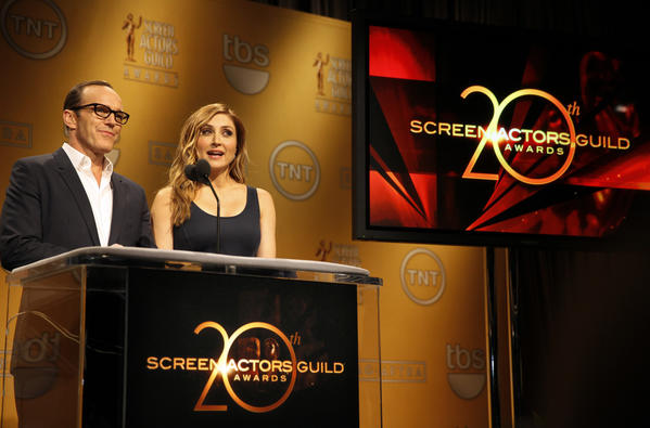 Actors Clark Gregg, left, and Sasha Alexander, right, announce the 20th Annual SAG Awards Nominations at the Pacific Design Center in Los Angeles on December 11, 2013.