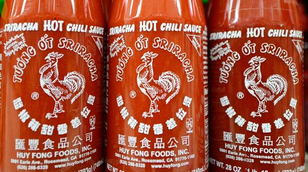 Bottles of Sriracha chili sauce on shelves inside a supermarket in Rosemead.