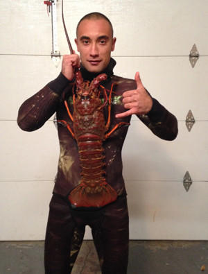 Joseph Ali found an especially large, nearly 18-pound lobster off the Huntington Beach Pier.