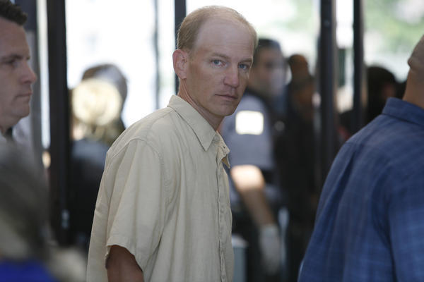 Daniel McCormack (center) arrives at the Cook County Criminal Courts Building in Chicago in 2008.