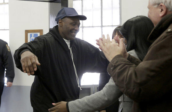 Stanley Wrice goes to hug his daughter Gail Lewis as he is released from the Pontiac Correctional Center in Pontiac, Ill., today. Wrice, who has spent over 30 years in prison, was convicted of rape, deviate sexual assault, armed violence and unlawful restraint and sentenced to 100 years in prison in 1983. On Tuesday a judge granted Wrice a new trial.