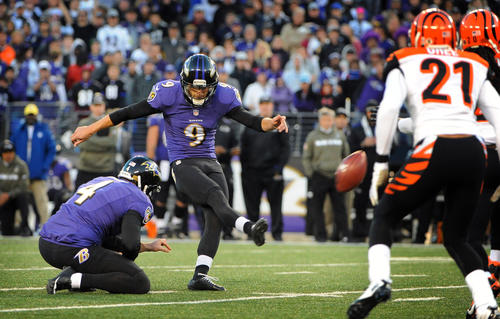 Ravens kicker Justin Tucker makes a 46-yard field goal in overtime, as Sam Koch holds, to beat the Cincinnati Bengals at M&T Bank Stadium.