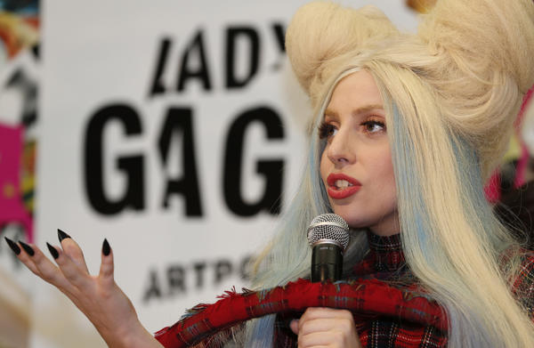 "Lady Gaga speaks during a news conference to promote her new album ""ARTPOP"" in Tokyo. The album opened at No. 1 but sales have been disappointing."