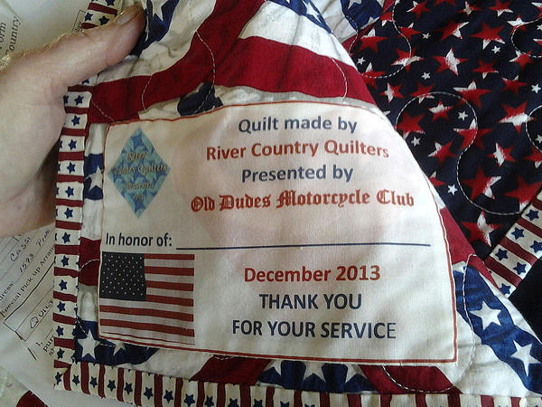 Quilts of Valor will be delivered to patients at the Veterans Administration hospital in Hampton Saturday by members of the Old Dudes motorcycle group. Cassi Fritzius of Gloucester organized the quilt project using a donation from the Old Dudes and help from by River Country Quilters in Gloucester and Sisters by Choice, a quilting bee in Virginia Beach.