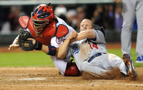 The Los Angeles Dodgers' Mark Ellis is tagged out at the plate by St. Louis Cardinals catcher Yadier Molina in the 10th inning during Game 1 of the National League Championship Series.