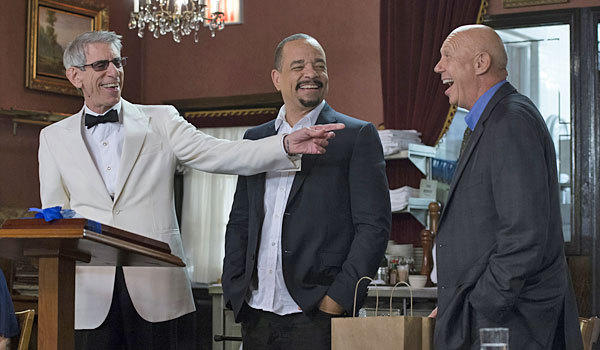 Dann Florek, right, plays Capt. Cragan at the retirement party for Det. John Munch (Richard Belzer), left, with Det. Tutuola (Ice-T).
