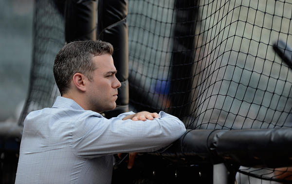 Theo Epstein, President of Baseball Operations for the Cubs, watches batting practice before a game against the White Sox.