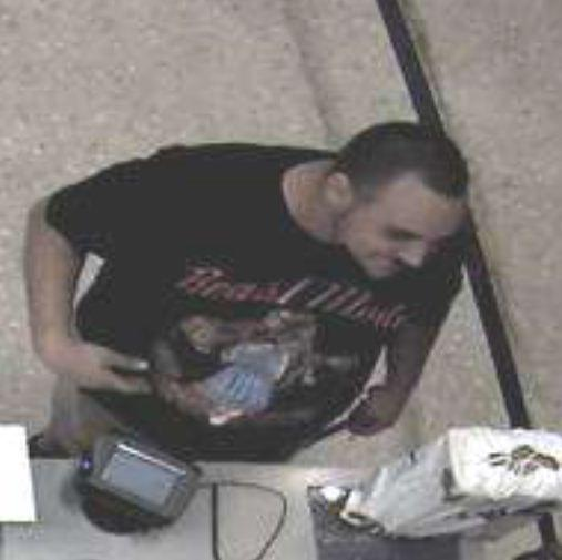 Sunrise Police are searching for the man seen in surveillance pictures shopping with a stolen VISA debit card