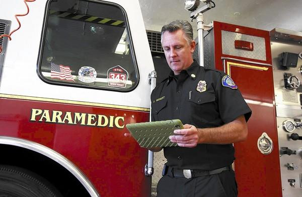 Laguna Beach EMS division chief Api Weinert demonstrates the use of a department issued iPad that can now transmit patient data to hospitals to negate the use of paper copies.