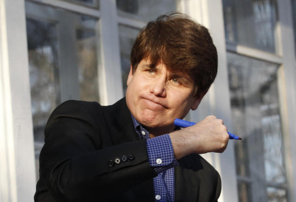 Former Gov. Rod Blagojevich acknowledges the crowd after delivering a statement on his last full day of freedom at his Chicago home on March 14, 2012.