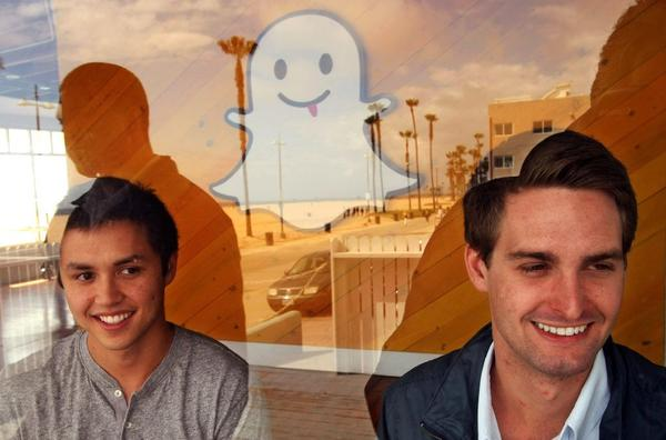 Snapchat has raised $50 million in funding from Coatue Management. Above, co-founders Bobby Murphy, left, and Evan Spiegel in Venice.