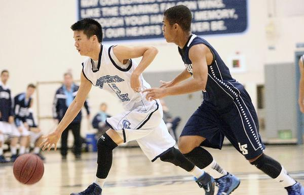 Crescenta Valley High's Eric Bae drives past La Salle's Jason Dalcour during a nonleague game on Wednesday. The Falcons defeated the Lancers, 80-61. (Roger Wilson/Staff Photographer)