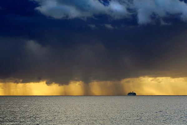 Sun Sentinel file photo of rain shower off Fort Lauderdale beach.