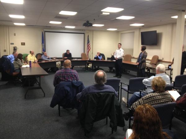 Canton Director of Emergency Management Adam Libros and Director of Senior and Social Services Claire Cote, standing, talk about efforts to train a community emergency response team. New team members were welcomed by the board of selectmen when it met on Dec. 11.