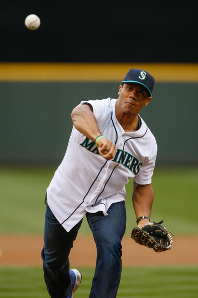 Quarterback Russell Wilson of the Seattle Seahawks, throws out the ceremonial first pitch prior to the game between the Seattle Mariners against the New York Yankees June 2013.