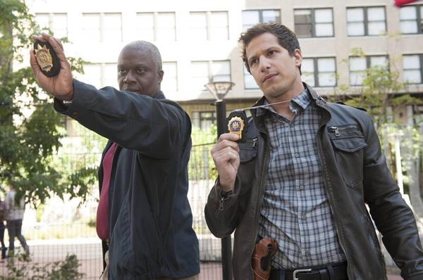 "Capt. Ray Holt (Andre Braugher, left) and Det. Jake Peralta (Andy Samberg) chase down a graffiti tagger in ""Brooklyn Nine-Nine."""
