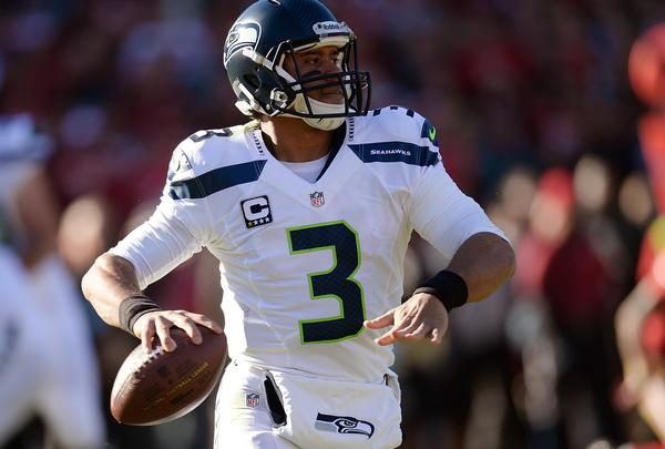 Russell Wilson of the Seattle Seahawks rolls out to pass against the San Francisco 49ers during the first quarter at Candlestick Park on Sunday.