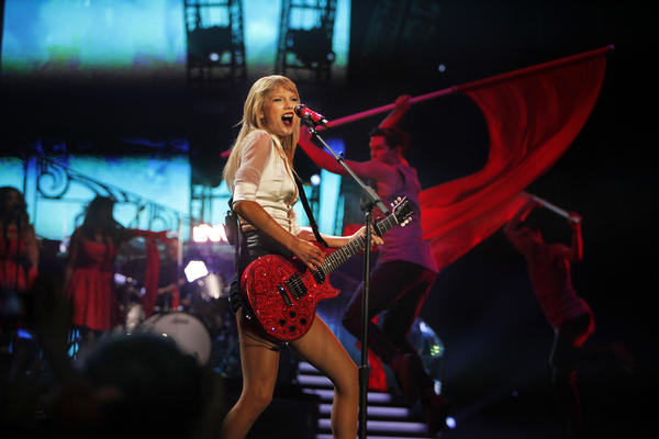 "Taylor Swift, seen performing at Staples Center, is among the nominees for the Golden Globe for original song with her tune ""Sweeter Than Fiction."""