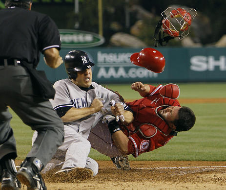 Yankees' Mark Teixeira collides with Angels catcher Bobby Wilson at Angel Stadium.