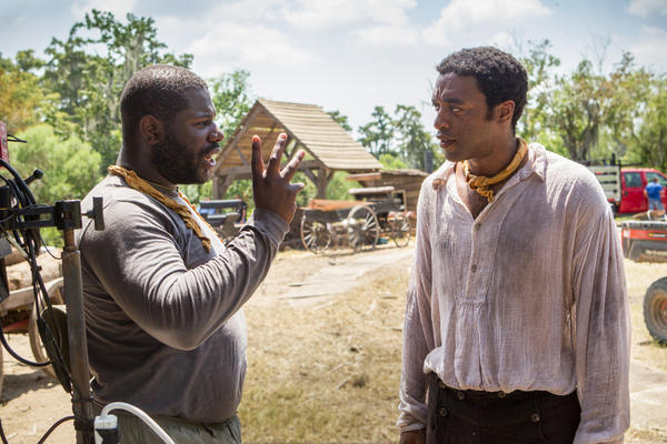 "Director Steve McQueen, left, and actor Chiwetel Ejiofor during the filming of ""12 Years A Slave."" McQueen has been nominated for a Golden Globe for his directing of the movie."