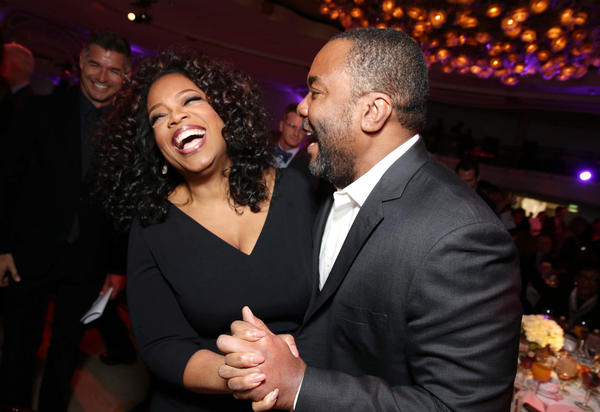 "Oprah Winfrey and Lee Daniels, who directed her in ""The Butler,"" share a laugh at the Hollywood Reporter's ""Power 100"" Women in Entertainment Breakfast on Wednesday in Beverly Hills."
