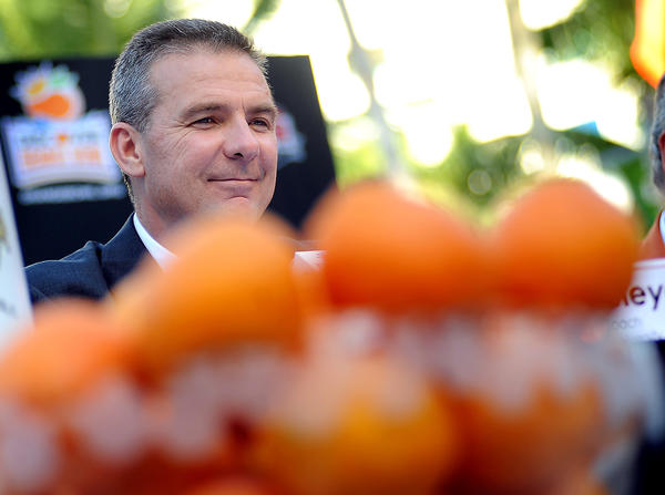 Ohio State coach Urban Meyer smiles during an afternoon press conference that also included Clemson coach Dabo Swinney. The teams will meet in the 80th Orange Bowl Classic on Jan. 3 in Miami Gardens.