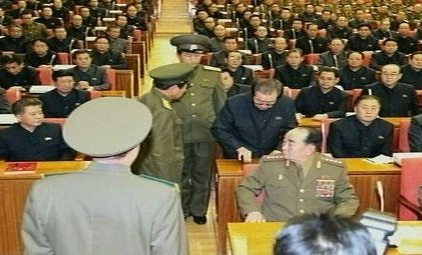 This image from North Korea's KCTV shows Jang Song Taek, second row, being dragged from his chair by two police officials during a meeting in Pyongyang.