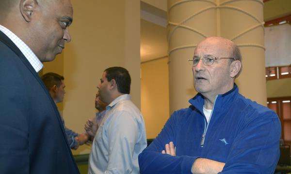 De Jon Watson, Dodgers vice president of player development, left, speaks with Dodgers president and CEO Stan Kasten during a break at baseball's winter meetings Thursday. Kasten says the team is dedicated toward not trading away its top prospects.