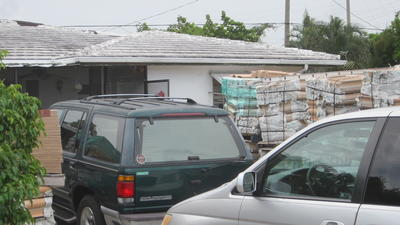 Piles of tiles draw Boca Raton code enforcement hammer