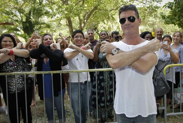 "In July, notorious bachelor and ""X Factor"" judge Simon Cowell confirmed he and Lauren Silverman were expecting. The only snag is the 36-year-old New York socialite is the wife of his good friend, Andrew Silverman. The affair prompted the real estate mogul to file for divorce, which was finalized on Dec. 4."