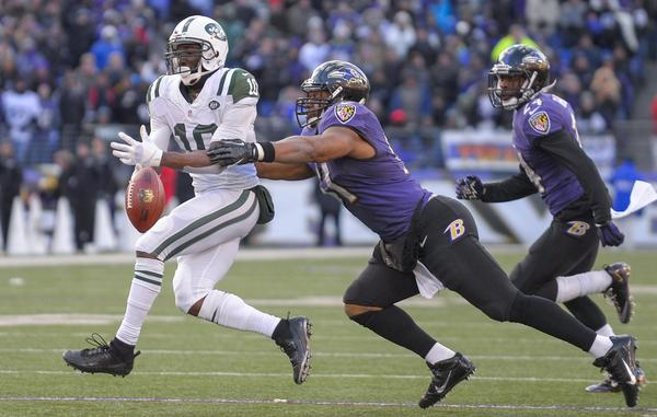 New York Jets wide receiver Santonio Holmes can't hang onto a pass while being defended by the Ravens' Daryl Smith during the second half of their Nov. 24 game, a Ravens win.