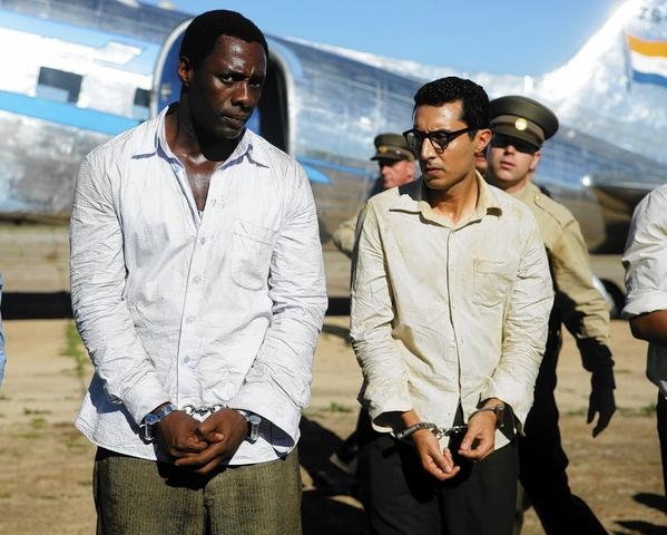 "Idris Elba, left,  and Riaad Moosa star in ""Mandela: Long Walk to Freedom."""